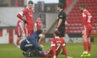 Aberdeen's Fraser Hornby is treated for an injury during the 1-0 defeat of Kilmarnock.
