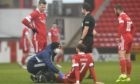 Aberdeen's Fraser Hornby is treated for an injury during the 1-0 defeat of Kilmarnock in February.