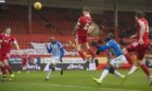Aberdeen's Callum Hendry scores the opening goal from a Niall McGinn free-kick to end Aberdeen's scoring drought.