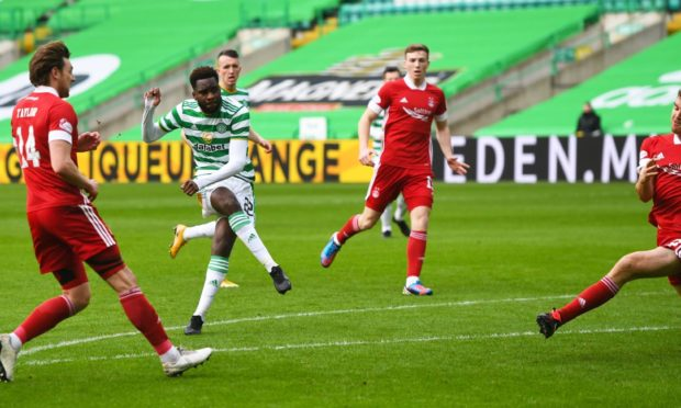 Odsonne Edouard of Celtic scores to make it 1-0 against Aberdeen at Parkhead.