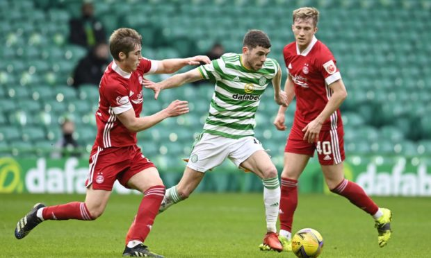 Celtic's Ryan Christie and Aberdeen midfielder Dean Campbell in action on Saturday.