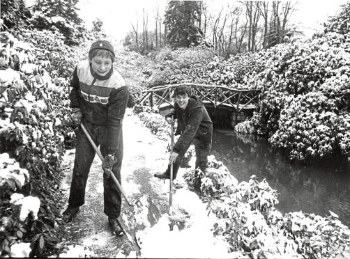 1988: Gardeners at Johnston Gardens clear the paths after yesterday's mornings snowfall. They are Campbell Kelso, (right), 29 Bank Street, Aberdeen, and Graham Rennie, Lonard Cottage, Drumoak.