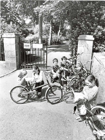 1981: A moment to lock up the bikes before these children get ready to enjoy the magic of the gardens.