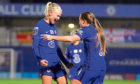Chelsea's Pernille Harder (left) celebrates scoring against Arsenal.