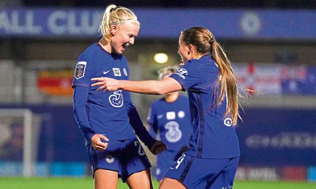 Chelsea's Pernille Harder (left) celebrates scoring against Arsenal.
