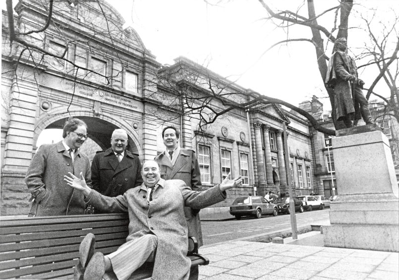 1992: Another picture of the four men at the Schoolhill Pocket Park, as Mr Middleton tries one of the benches in the park.