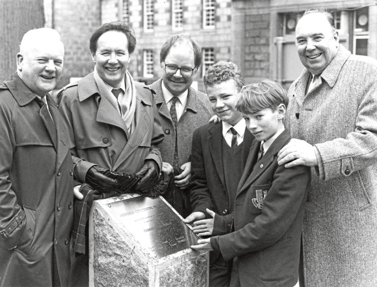 1992: Two Gordons College pupils join the official party who unveiled the plaque to mark the completion of the Pocket Park at Schoolhill yesterday. Here, Greg Mackie (15) and Peter MacKay (12), both from Aberdeen, are seen with, from left: Commercial Union branch manager Mr Alistair Smith, Aberdeen District Council policy convener Mr Jim Wyness, district manager of Scottish Homes Mr Brian Watson and Grampian Regional Council convener Mr Bob Middleton.