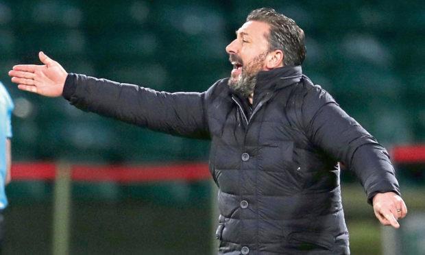 Aberdeen manager Derek McInnes gestures on the touchline during the Scottish Premiership match at Celtic Park, Glasgow.