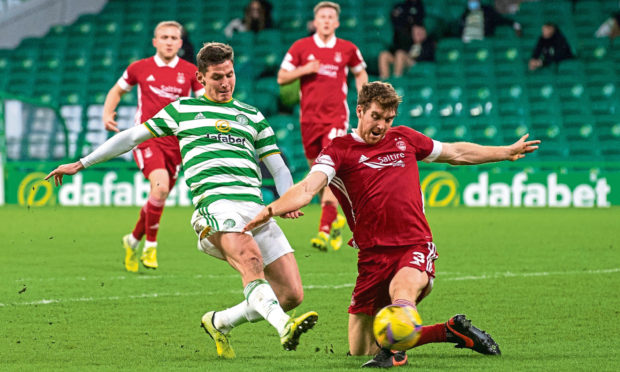 Tommie Hoban, right, in action for Aberdeen against Celtic.