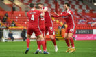 The wait is over - Aberdeen's Callum Hendry celebrates scoring to make it 1-0 against Kilmarnock with Andy Considine, Ash Taylor and Connor McLennan.