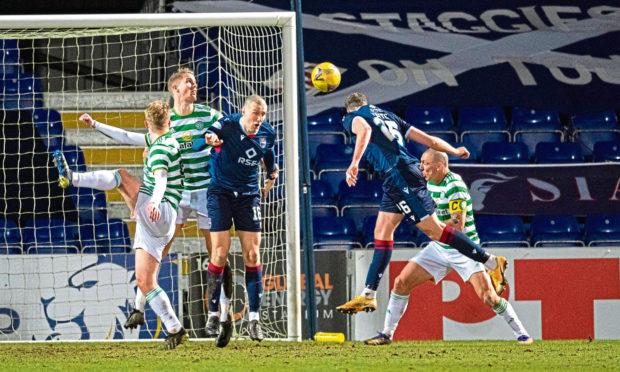 Jordan White heads home for Ross County in their win over Celtic.