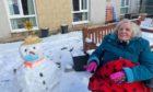 Ada Milne and Jean Runcie having a snowball fight.