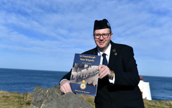 Author Michael Strachan with his book.