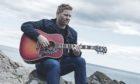North-east singer-songwriter Colin Clyne has won a prestigious international song contest.