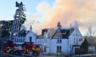 Fire crews battling the blaze at the Old Mill Inn