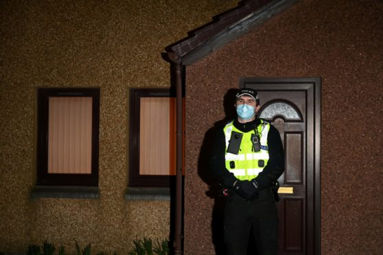 A police officer stands guard outside the property in Cove's Allison Close after the body of Christina Malley was found.