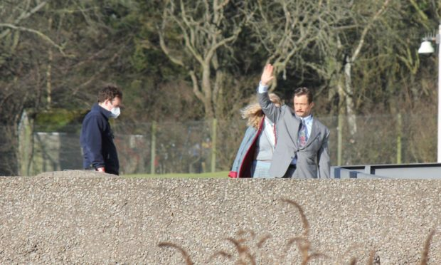 Tetris star Taron Egerton waves to watching fans from Tillydrone set of the Jon S Baird movie today.