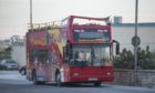 The sightseeing tour bus after the collision.