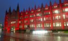 Marischal College lit up in red for Care Day
