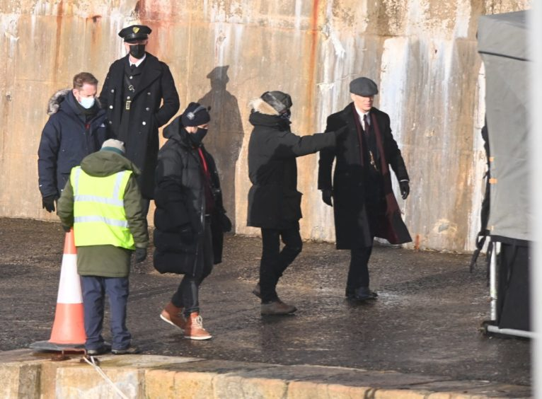 Cillian Murphy, facing the camera, at Portsoy Harbour. Picture by Paul Glendell