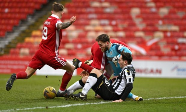 Callum Hendry, left, tries to force the ball home but to no avail.
