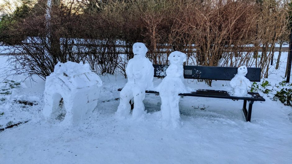 One snow family found it all too much and required a rest on one of the park's public benches