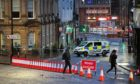 """A police cordon at West George Street in Kilmarnock, where officers continue to investigate what Police Scotland describe as a """"serious incident"""" in the grounds of a local hospital and another location in the area."""