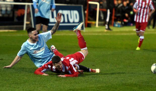 Deveronvale defender Kevin Adams tackles Formartine's Graeme Rodger.