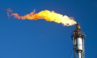 Flaring off gas at the Flotta oil terminal on the Island of Flotta.