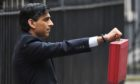 Rishi Sunak, Chancellor of the Exchequer, leaves No.11 Downing Street, ahead of delivering his budget.