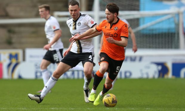 Andy Considine battling for possession with Marc McNulty during the defeat at Tannadice.