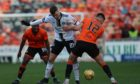 Florian Kamberi, centre, battles with Ryan Edwards for the ball.