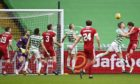 Ash Taylor has his header cleared off the line during the Scottish Premiership match between Celtic and Aberdeen.