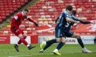 Aberdeen striker Florian Kamberi shoots at gol.