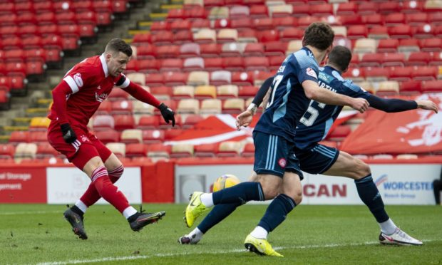 Aberdeen striker Florian Kamberi shoots at gol.