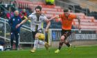 Connor McLennan, left, tries to get away from Jamie Robson