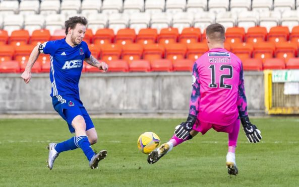 Mitch Megginson in action for Cove Rangers against Partick Thistle.