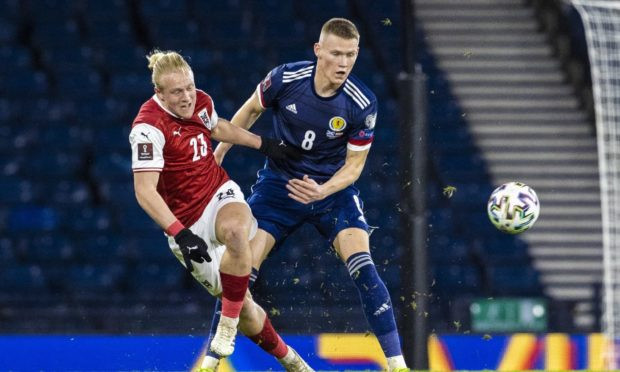 Scott McTominay, right, in action for Scotland against Austria