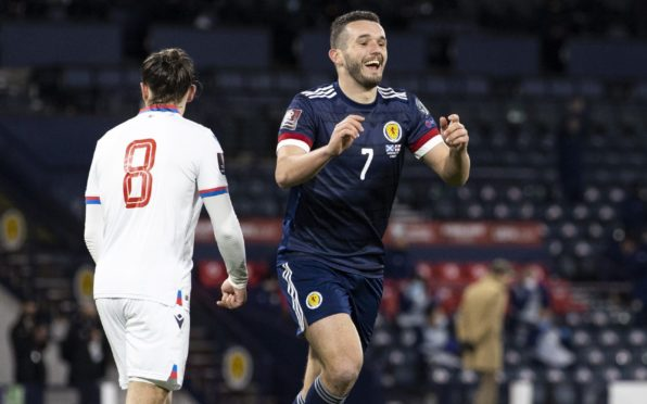 Scotland's John McGinn celebrates after scoring to make it 1-0 during a World Cup qualifier against Faroe Islands.