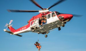 Members of the Babcock SAR team engaged in a training exercise in the North Sea