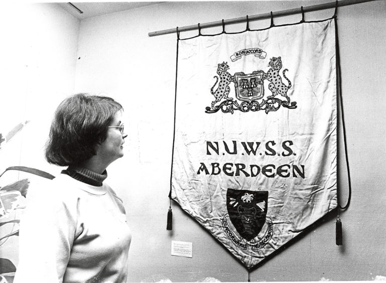 1982: Deborah Rolland, keeper of Museums at James Duns House, with the banner of the Aberdeen branch of the National Union of Women's Suffrage Societies from the early 1900s.