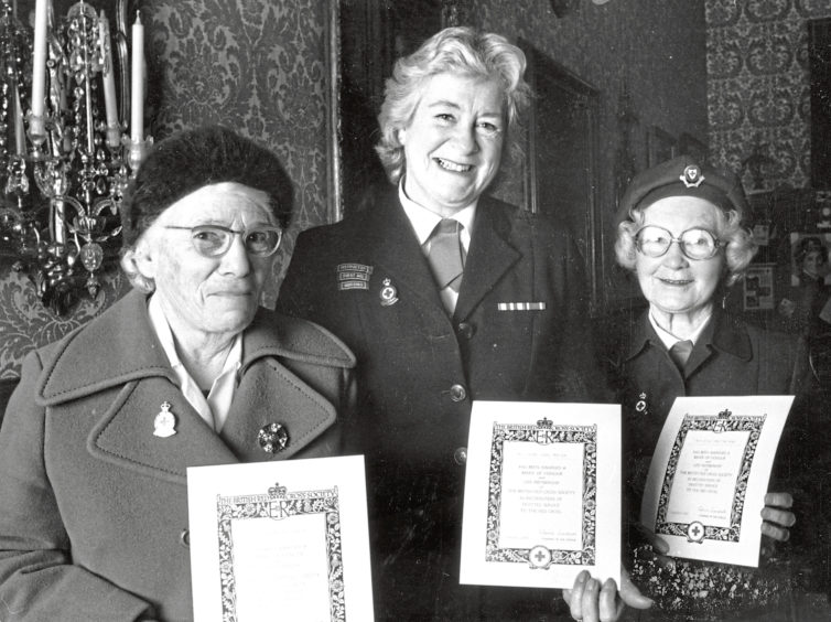 1987: Many years of devoted service to the Red Cross have been marked for three North-east women with the award of badges of Honour. Here after the ceremony at the Town and County Hall, Aberdeen, the three show their awards. They are (from left): Miss Helen Duncan, Carnegie Crescent, Aberdeen; Mrs Yvonne Morison, Mountblairy, Alvah, and Miss Jessie Grant, Cairncry Crescent, Aberdeen. The badges were presented my Mrs Hope Readman, Chairman Scottish branch council of the British Red Cross.