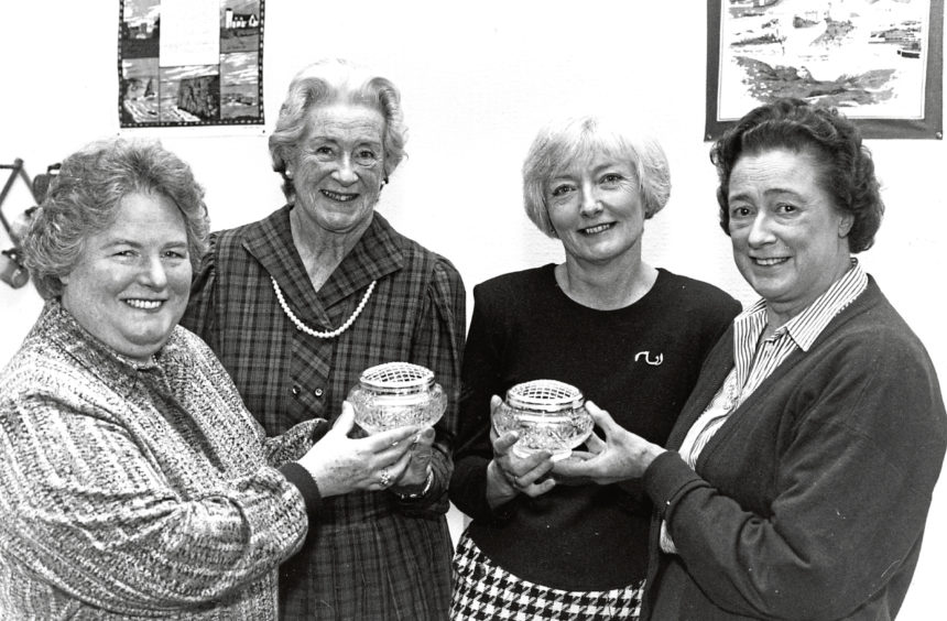 1992: Yvonne Morison (second from left), from Banff, receives an engraved bowl from Clare Dixon-Carter, Chairman of the governing body Scottish Central Council Branch, and Pam Martin (second from right) receives her bowl from Heather Barlas, President of Grampian branch Red Cross.
