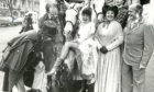 1988: Lyric Musical Society hostess Mary Webster shows a leg to some of the cast outside the theatre.