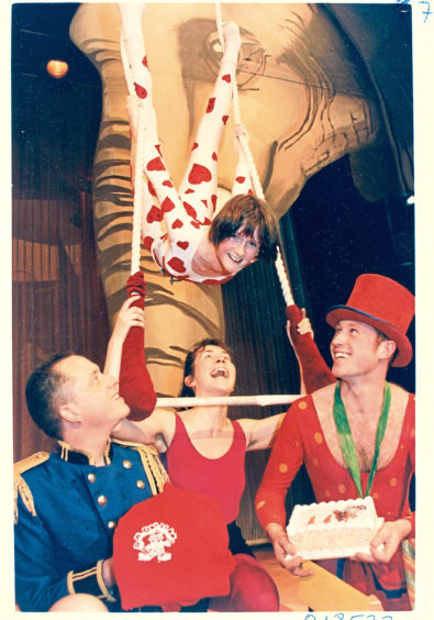 1994: Scotland's youngest trapeze artiste Wendy Ross, celebrates her 13th birthday rehearsing for the Lyric Musical Society production of Barnum at His Majesty's Theatre. Presenting her with a cake and sweatshirt are (from left): Tom Thumb (George R Mitchell), Scaramouche (Nicki McCretton), and Ring Master (Barry Cameron).