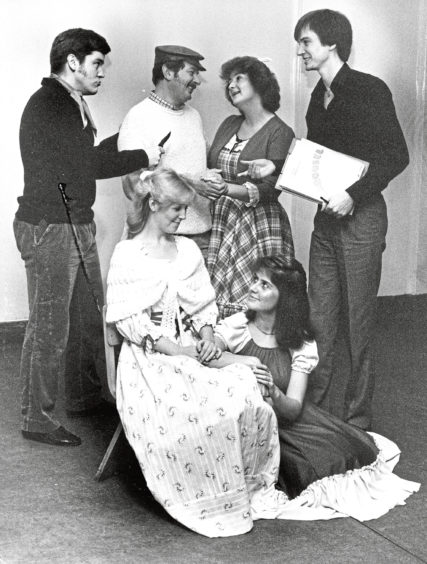 1987: Rehearsal for the Lyric Musical Society's production of Carousel are now well under way for the showing in His Majesty's Theatre starting on March 23 after the sudden death of producer Celia Strachan just before Christmas. Lyric member Callum Stuart (right), a former pupil of Celia's and now a teacher of drama in the Alford area, has agreed to take over as produced. Callum is shown at rehearsal with cast members (left to right, back) Andrew Begg (Jigger), Ian Webster (Enoch Snow), Anne Gordon (Carrie) and (left to right, front) Rhonda Mair (Julie) and Mhorag Mair (Louise).