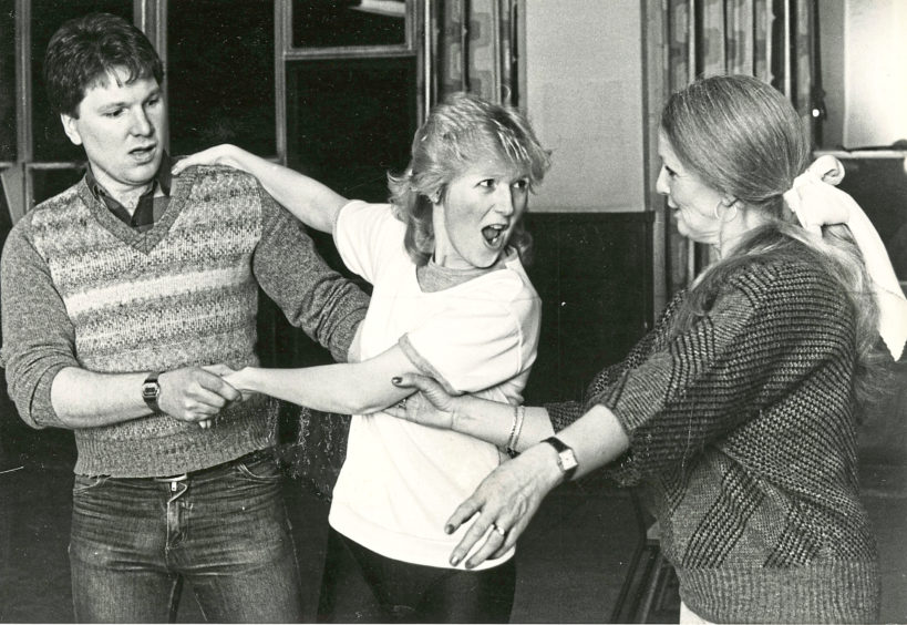 1985: Donald Munro and Rhonda Mair, who play Tommy and Winnie Tait in Annie, get a helping hand during rehearsals.
