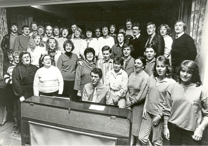 1985: Getting into the swing of things are the members of the Lyric Musical Society who are pictured at their first rehearsal for Hello Dolly to be staged at HM Theatre next March, their 30th show at the theatre. Musical director Ewen Ritchie (at piano) put them through their paces at Beechwood School last night.