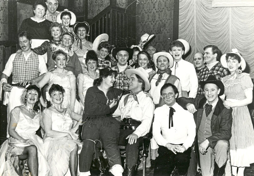 1988: A happy scene from the Lyric Musical Society's production of Calamity Jane which goes on at the Music Hall from tonight until Saturday. Anne Gordon (centre) who plays Calamity and Andrew Begg (Wild Bill Hickock) are surrounded by members of the cast.