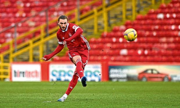 Aberdeen's Fraser Hornby shooting at goal.